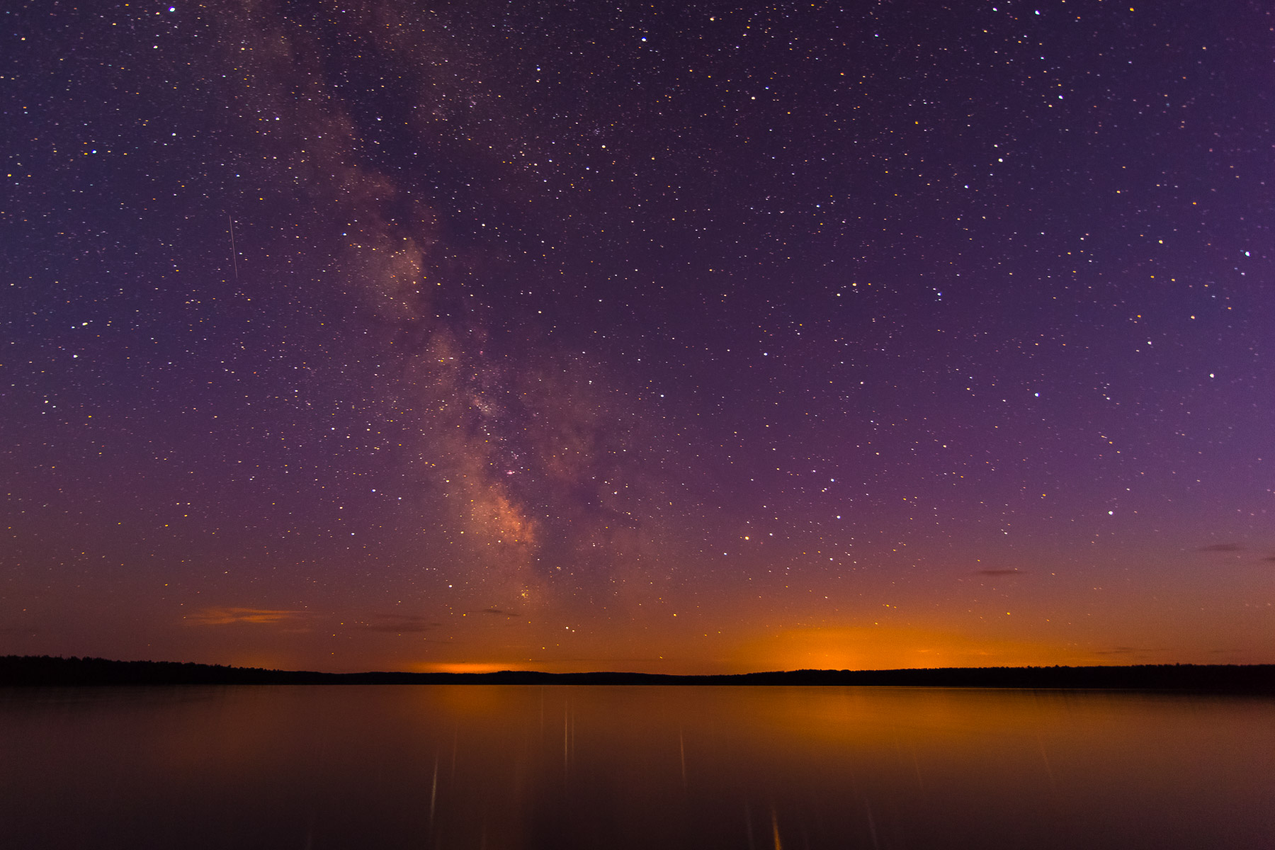 Dusky stars reflecting over the water.